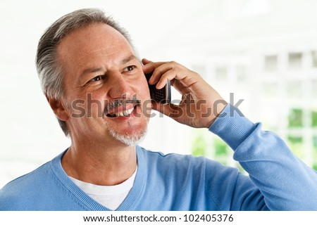Portrait of a successful mature man talking on the phone - stock photo