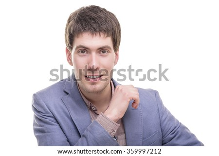 Portrait of a successful smiling young businessman in blue suit isolated. - stock photo
