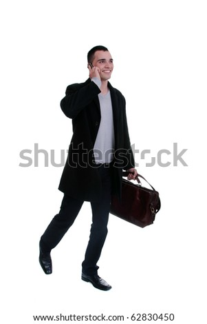 Portrait of a successful young business man on the phone carrying a suitcase on white background