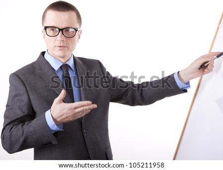 Portrait of a successful young business man pointing with his left hand.