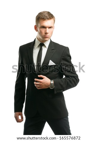 Portrait of a successful young business man standing isolated on white background