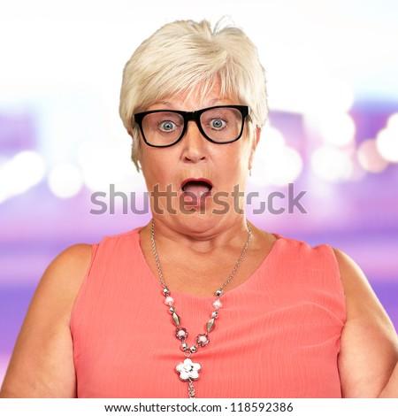 Portrait Of A Surprise Mature Woman, Background - stock photo