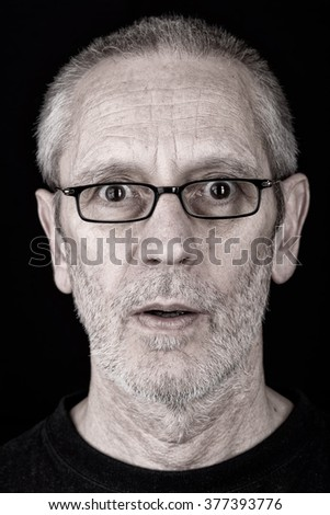 Portrait of a surprised and confident man wearing glasses, with open mouth - stock photo