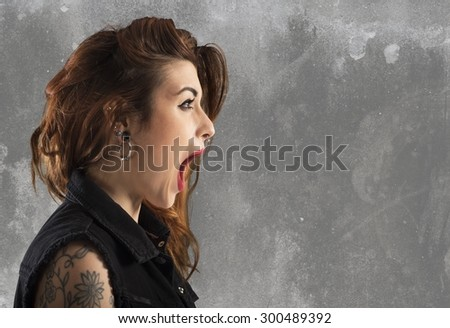 Portrait of a surprised astonished girl screaming - stock photo