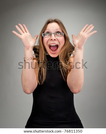 Portrait of a surprised attractive business woman - stock photo