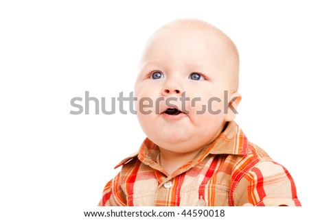 Portrait of a surprised baby boy looking up - stock photo