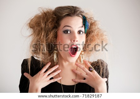 Portrait of a surprised woman with a messy hairdo - stock photo