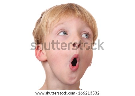Portrait of a surprised young boy  on white background - stock photo