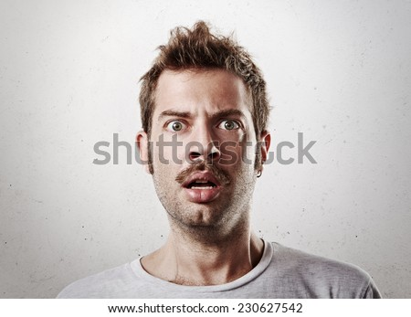 Portrait of a surprised young man - stock photo