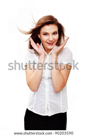 Portrait of a surprised young woman against white background - stock photo