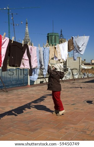portrait of a sweet girl with the clothesline. urban scene - stock photo