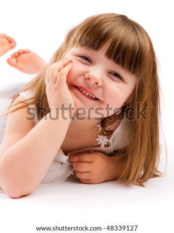 Portrait of a sweet laughing preschool girl - stock photo