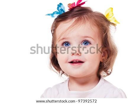 Portrait of a sweet little girl with butterflies on head - stock photo