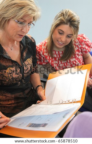 Portrait of a teacher and a student - stock photo