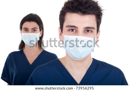 portrait of a team of doctors, man and woman wearing mask and uniform isolated on white background (focus on man)