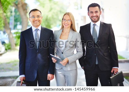 Portrait of a team of professional business workers with cheerful smiles and elegant looks