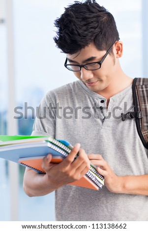 Portrait of a teenage boy at college - stock photo
