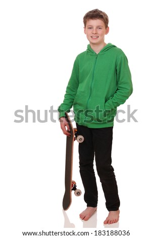 Portrait of a teenage boy with skateboard on white background - stock photo