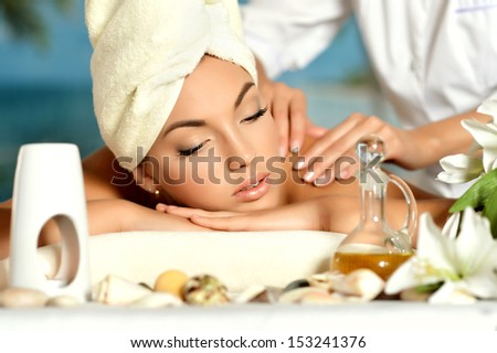 Portrait of a teenage girl at body massage - stock photo