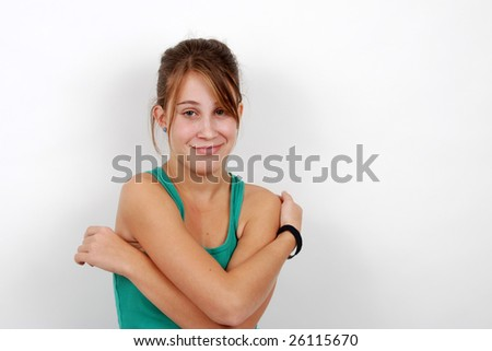 Portrait of a teenage girl looking at the camera - stock photo