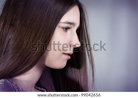 Portrait of a teenage girl of thirteen - stock photo