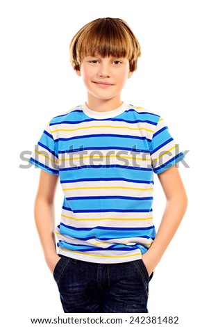Portrait of a ten years boy smiling at camera. Isolated over white. - stock photo