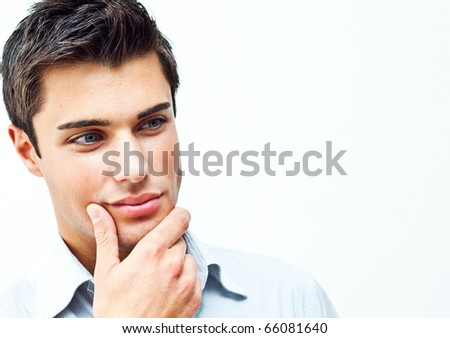 Portrait of a thoughtful attractive man. Lots of copy-space on the right. - stock photo