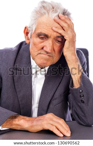 Portrait of a thoughtful old man isolated on white background - stock photo