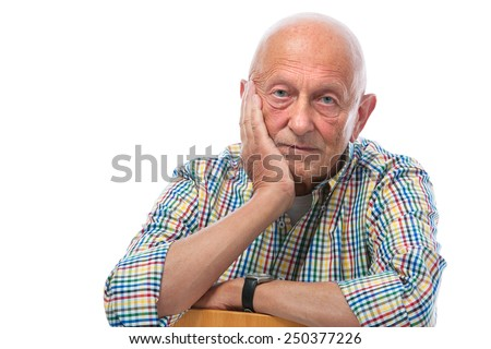 Portrait of a thoughtful senior man looking at the camera - stock photo
