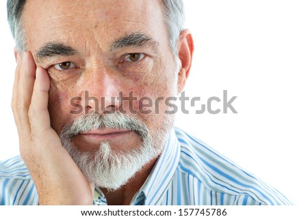 Portrait of a thoughtful senior man on white background - stock photo