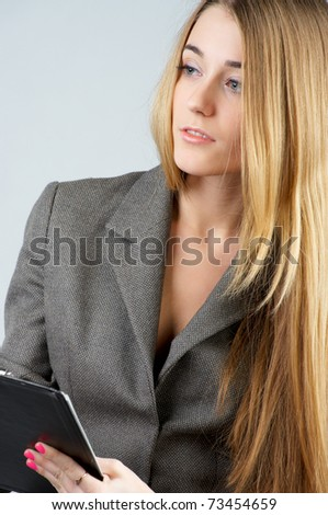 Portrait of a thoughtful young businesswoman looking into distance - stock photo