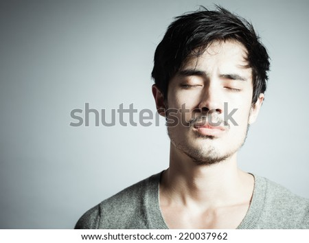 Portrait of a thoughtful young man - stock photo