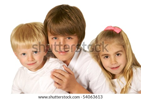 Portrait of a three beautiful brothers and sister all snuggled together in white tee shirts - stock photo