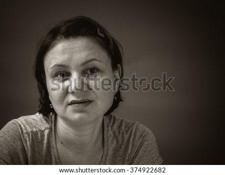 Portrait of a tired mature woman.  - stock photo