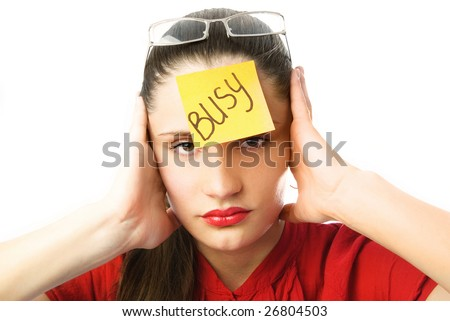 """portrait of a tired unhappy businesswoman with a note """"busy"""" on her forehead - stock photo"""