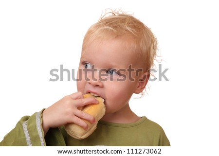 Portrait of a toddler eating some bread on white background