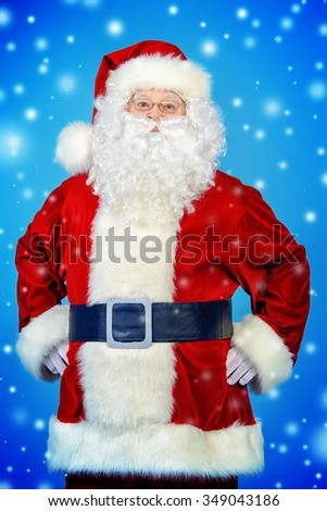 Portrait of a traditional Santa Claus over blue background. Studio shot. Christmas. - stock photo