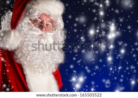 Portrait of a traditional Santa Claus. Over dark background. Christmas. - stock photo