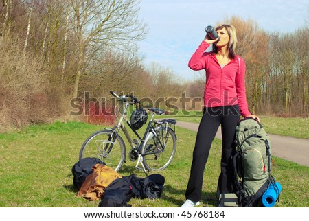 Portrait of a traveler girl with a bicycle - stock photo