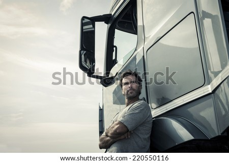 Portrait of a truck driver - stock photo