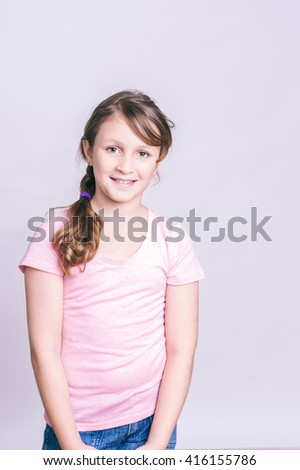 portrait of a tween girl with long brown hair - stock photo
