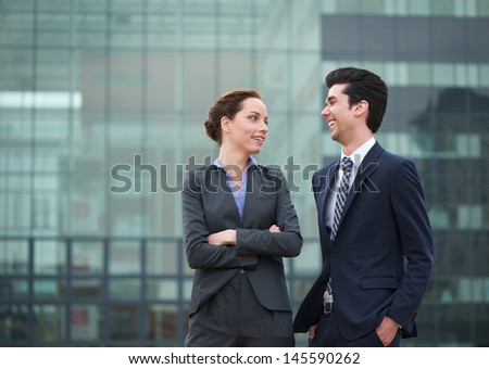 Portrait of a two business colleagues smiling outdoors in the city - stock photo