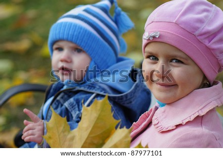 portrait of a two kids at bench