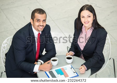 Portrait of a two young business colleagues during a business meeting. Top view. - stock photo