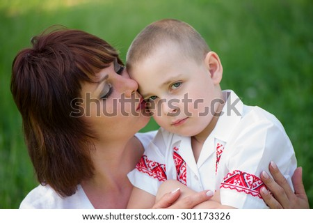 Portrait of a Ukrainian mother and son in the countryside - stock photo