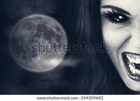 Portrait of a vampire lady with moon in background. - stock photo