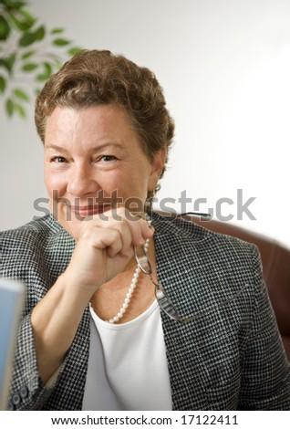 Portrait of a very attractive, confident businesswoman - stock photo