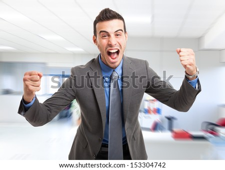 Portrait of a very happy business man in his office - stock photo