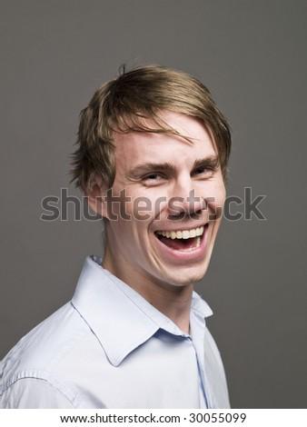 Portrait of a very happy man - stock photo