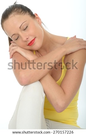 Portrait of a Very Happy Relaxed Contented Attractive Young Woman Wearing a Bright Yellow Vest Top - stock photo